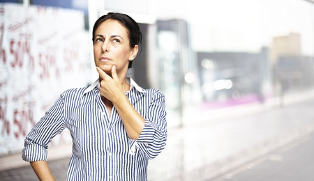 portrait of a middle aged woman thinking at street photo