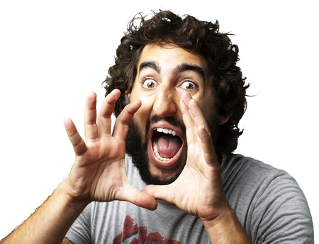portrait of young man screaming against a white background photo