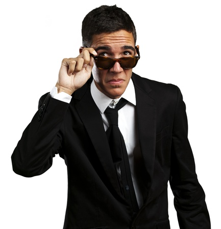 portrait of business man taking off the sunglasses against a white background photo