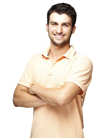 happy young man: portrait of a happy young man smiling against a white background