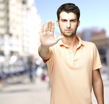 hand stop: man doing a stop gesture