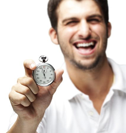 portrait of young man holding a stopwatch against a white background photo