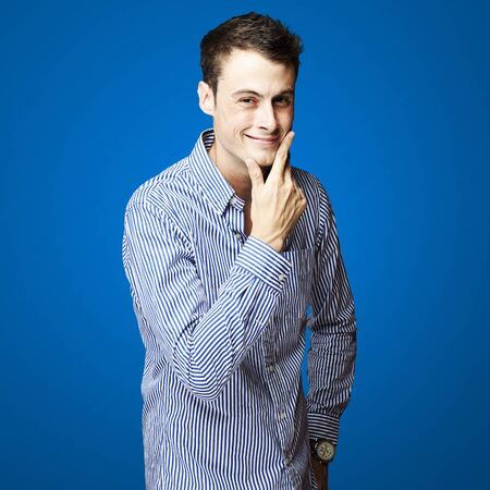 portrait of a handsome young man smiling over white background Stock Photo - 12656405