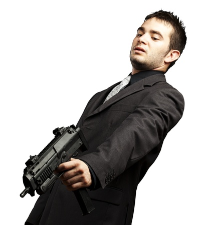 mafia man aiming down with gun against a white background Stock Photo