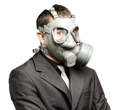 portrait of a business man with gas mask over white background Stock Photo - 12603905