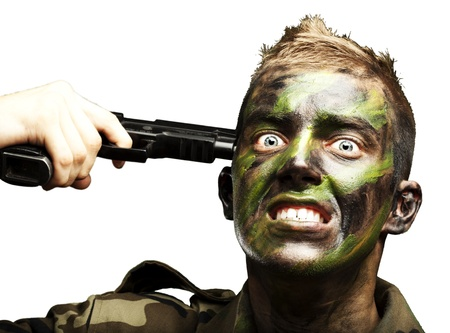 portrait of young soldier comiting suicide over white background Stock Photo - 12656264