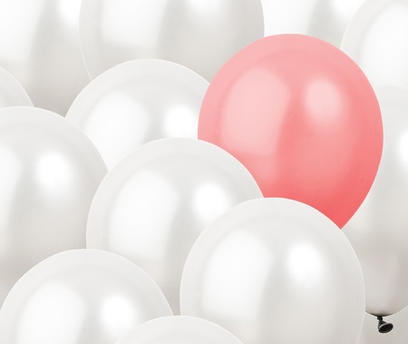 red balloon in between white balloons Stock Photo - 12603937