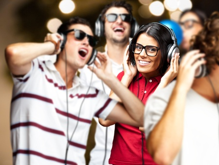 woman listening to music: portrait of young people having a party
