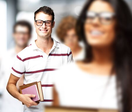 portrait of young students holding books indoor Stock Photo - 12656213