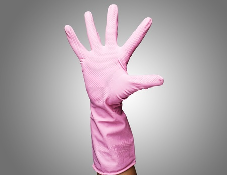 pink rubber gloves against a grey background Stock Photo - 12603460