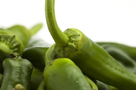 green peppers pile on a white background photo