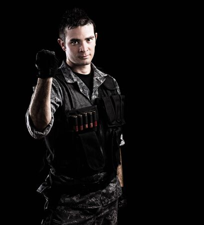 army men: serious young soldier tightening the fist on a red background Stock Photo