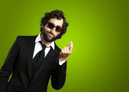 portrait of young business man gesturing money over green background Stock Photo - 12656800