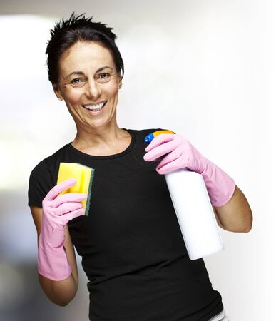 portrait of a middle aged woman ready to clean indoor photo