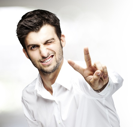 portrait of young man doing good symbol indoor photo