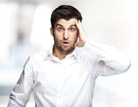 portrait of young man surprised indoor Stock Photo - 12656626
