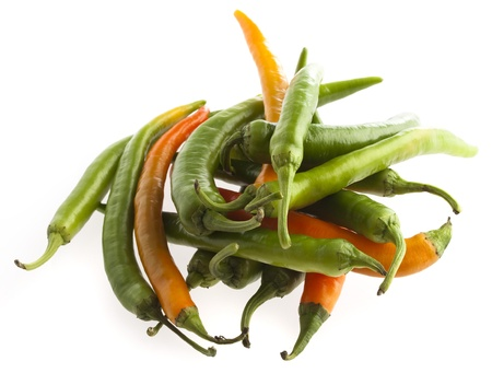 hottest: green and red chilli peppers on a white background