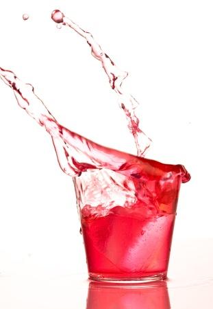 splash mixed: cocktail splashing into glass on white background Stock Photo