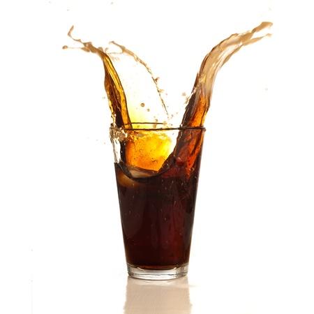 ice tea: brown beverage splash isolated on white background Stock Photo