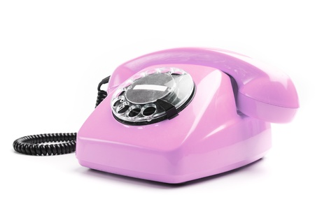 vintage pink telephone isolated over white background photo