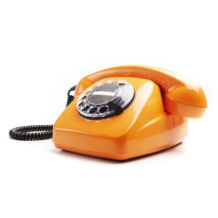 phone cord: vintage orange telephone isolated over white background