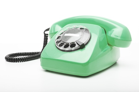 vintage green telephone isolated over white background photo