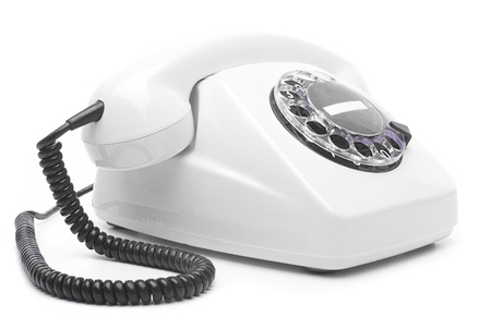 vintage white telephone isolated over white background photo
