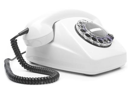 vintage white telephone isolated over white background photo