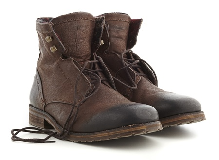 combat boots: brown boots isolated on a white background Stock Photo