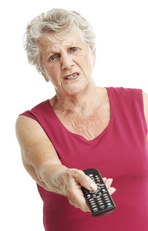 portrait of bored senior woman holding a tv control over white photo