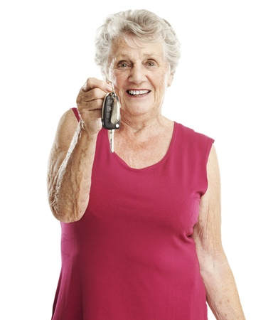 portrait of senior woman holding a tv control over white photo
