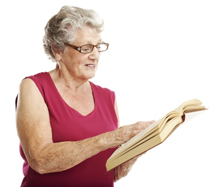 portrait of senior woman reading a book over white background photo