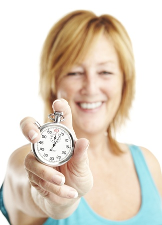 portrait of middle aged woman holding stopwatch over white photo