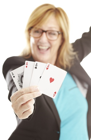 portrait of middle aged woman showing poker cards