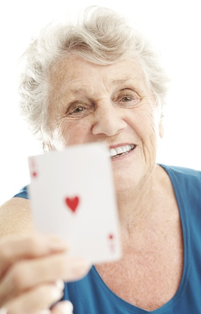 portrait of senior woman showing poker cards over white Stock Photo - 12656706