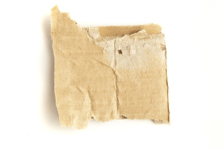 extreme closeup of cardboard piece on a white background photo