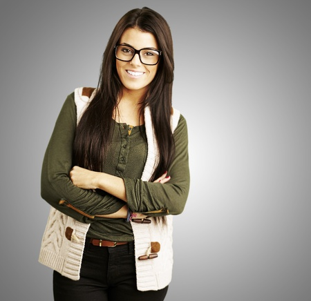 fashion glasses: portrait of young woman standing isolated against a grey background Stock Photo