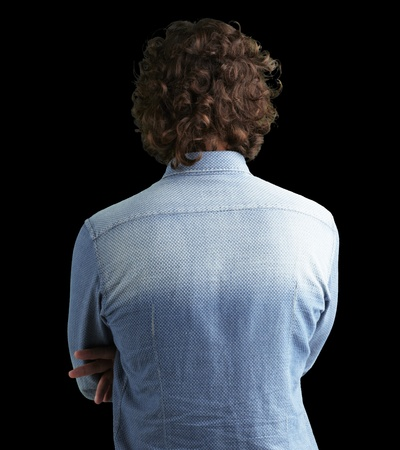 back of head: Back side view of a man against a black background Stock Photo