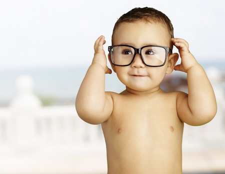 happy young boy wearing glasses, outdoor photo