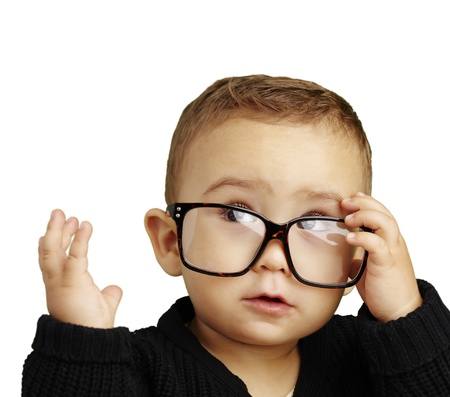 young boy wearing glasses and looking up against a white background photo
