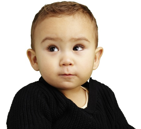 handsome young boy looking up against a white background Stock Photo - 13486279