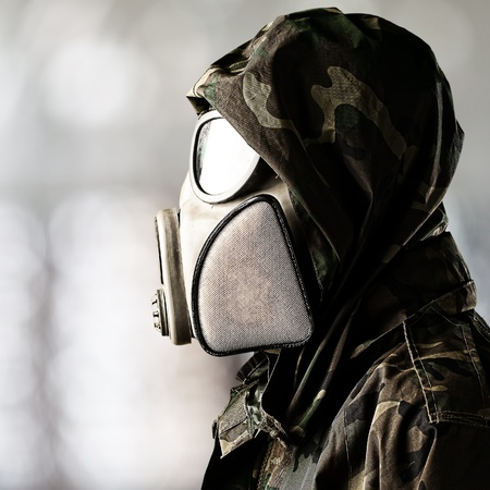 portrait of soldier wearing gas mask over abstract background photo