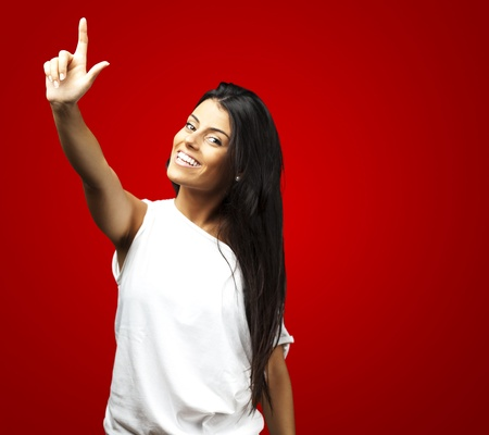 portrait of young woman request against a red background photo