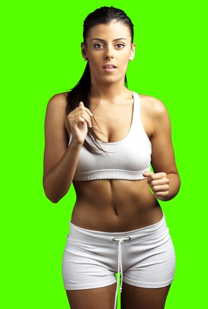 removable: portrait of a sporty young woman running against a removable chroma key background
