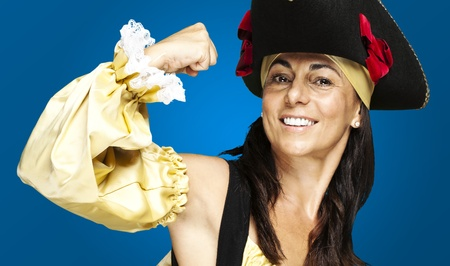 portrait of pirate woman gesturing against a blue background photo