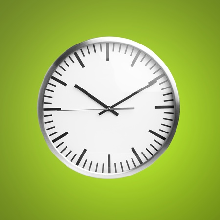clock isolated over green background photo