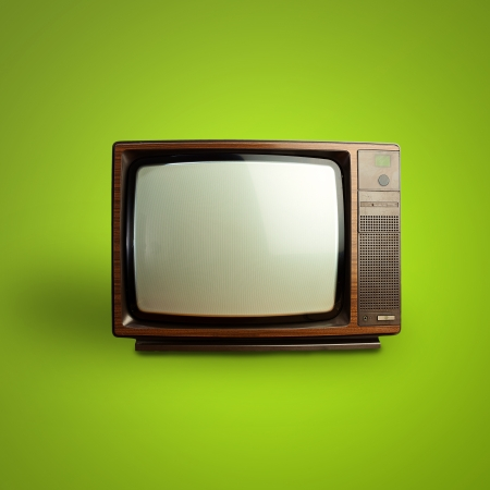 vintage television over green background photo