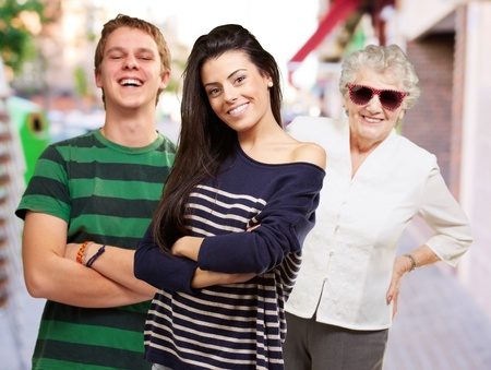 young friends with grandmother smiling at street Stock Photo - 13156640