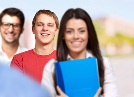 young students group smiling over abstract background photo