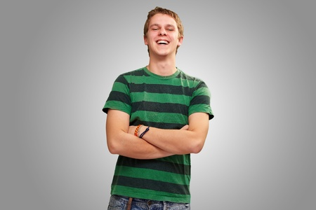 portrait of young man smiling over grey background Stock Photo - 13280395